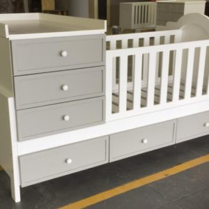 ROOM-IN-A-BOX - base is a single bed with cot and compactum on top.
